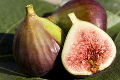 Figs. Close up of some figs -  one of them sliced Stock Image
