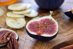 Figs. Fresh figs on an olive plate Royalty Free Stock Photo