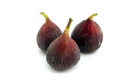 Figs. Three purple Brazil figs isolated on white Royalty Free Stock Photo