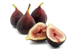 Figs. Three whole figs and one sliced one isolated on white Stock Image