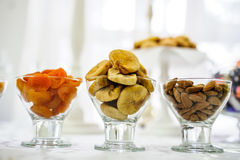 Figs, apricots, almonds in glass plate Royalty Free Stock Images
