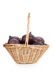 Figs in a basket isolated on white Stock Photography