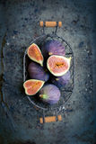 Figs in a basket on rustic metal background Royalty Free Stock Photo