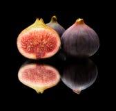 Figs on black Stock Photos
