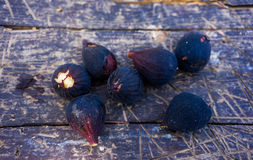 Figs. Black figs on a wooden table Royalty Free Stock Image