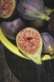 Figs in bowl on wood Royalty Free Stock Photos