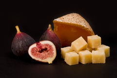 Figs and Cheese. Figs and two kinds of cheese on dark background Royalty Free Stock Photo