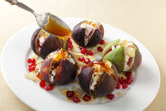 Figs with cheese and honey Stock Photo