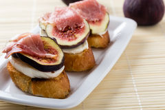 Figs with cheese and prosciutto Royalty Free Stock Image