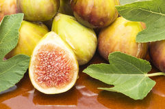 Figs. Fresh and ripe figs with fig leaves Royalty Free Stock Photos