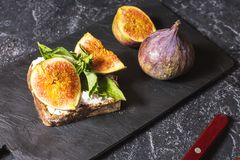 Free Figs Fruit Sandwich On A Slate Plate On A Black Background Royalty Free Stock Images - 125954469