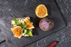 Free Figs Fruit Sandwich On A Slate Plate On A Black Background Stock Photos - 125954533