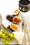 Figs, grape, cheese and glass of wine Stock Image