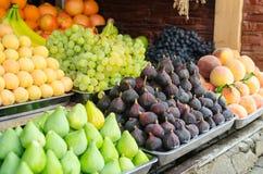 Figs, grapes, bananas, peaches, fresh fruits at a market Stock Photo