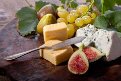 Figs, grapes and cheese Stock Photos