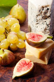 Figs, grapes and cheese Royalty Free Stock Photo