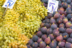 Figs and grapes at a market. Figs and grapes for sale at a market Stock Photo