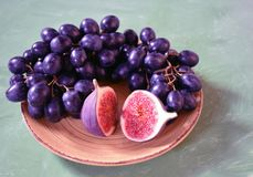 Fig and grape. Figs and grapes in a plate Royalty Free Stock Photo