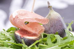 Figs with ham on rocket salad Stock Photo