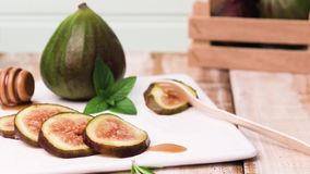 Figs and honey. On a wooden table selective focus stock video