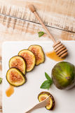 Figs and honey Stock Images