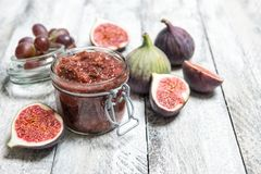 Figs jam in jar Fruit marmalade. Figs jam in jar. Fruit marmalade on rustic wooden background Royalty Free Stock Photo