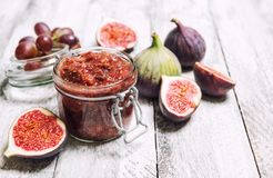 Figs jam in jar Fruit marmalade Homemade preserving. Figs jam in jar. Fruit marmalade on rustic wooden background. Homemade preserving royalty free stock photo