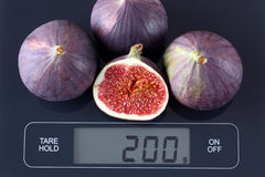 Figs on kitchen scale Royalty Free Stock Image