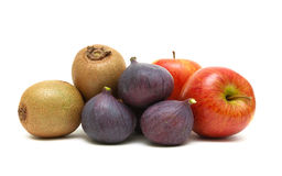 Figs, kiwi and apples isolated on white background Royalty Free Stock Photo