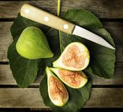 Figs and knife on a fig leaf. Stock Photo