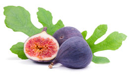 Figs with leaves. Some juicy figs and green leaves  on white Stock Photo