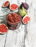 Figs marmalade in jar Fruit jam rustic wooden background. Figs marmalade in jar. Fruit jam on rustic wooden background. Preserving ingredients Stock Photos