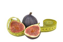 Figs with measuring tape Royalty Free Stock Photos