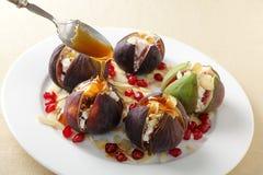 Figs med ost och honung Arkivfoto