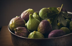 Figs. Metal cup filled with fresh figs royalty free stock photography