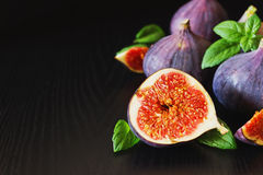 Figs and mint leaves Stock Images