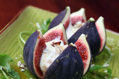 Figs with nut and honey cheese Royalty Free Stock Images
