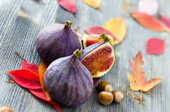 Figs, nuts and autumn leaves. Figs and nuts with autumn leaves selective focus Royalty Free Stock Image