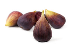 Figs Over White. Background.  Focus on front fig Stock Images