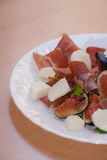 Figs with Parma ham and mozzarella cheese Royalty Free Stock Photography