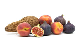Figs, peaches and coconut isolated on white background Stock Images