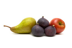 Figs, pear and red apple on a white background Royalty Free Stock Photography