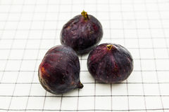 Figs on the plaid material Royalty Free Stock Photo