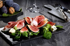 Figs with prosciutto Stock Photography
