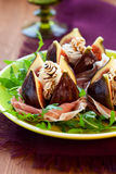 Figs with prosciutto,cheese and balsamic vinegar Royalty Free Stock Image