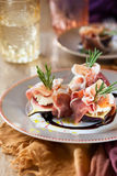 Figs with Prosciutto, Goat Cheese and Rosemary Royalty Free Stock Image