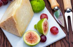Figs, red grapes and sheep`s cheese manchego type. stock image