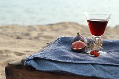 Figs and red wine. Fresh Figs and red wine on a denim background Stock Images