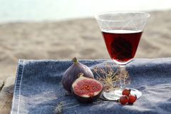 Figs and red wine. Fresh Figs and red wine on a denim background Royalty Free Stock Images
