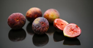 Figs. Ripe figs on black background royalty free stock photos